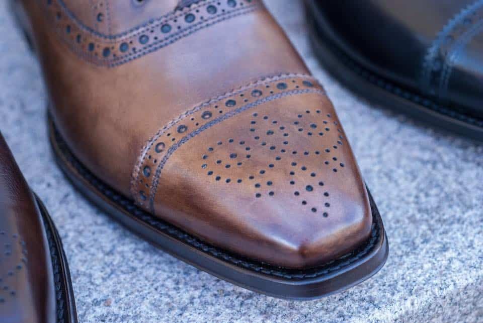 It's more or less impossible to separate a Blake/Rapid stitched shoe as this to a welted shoe when seen from the outside.