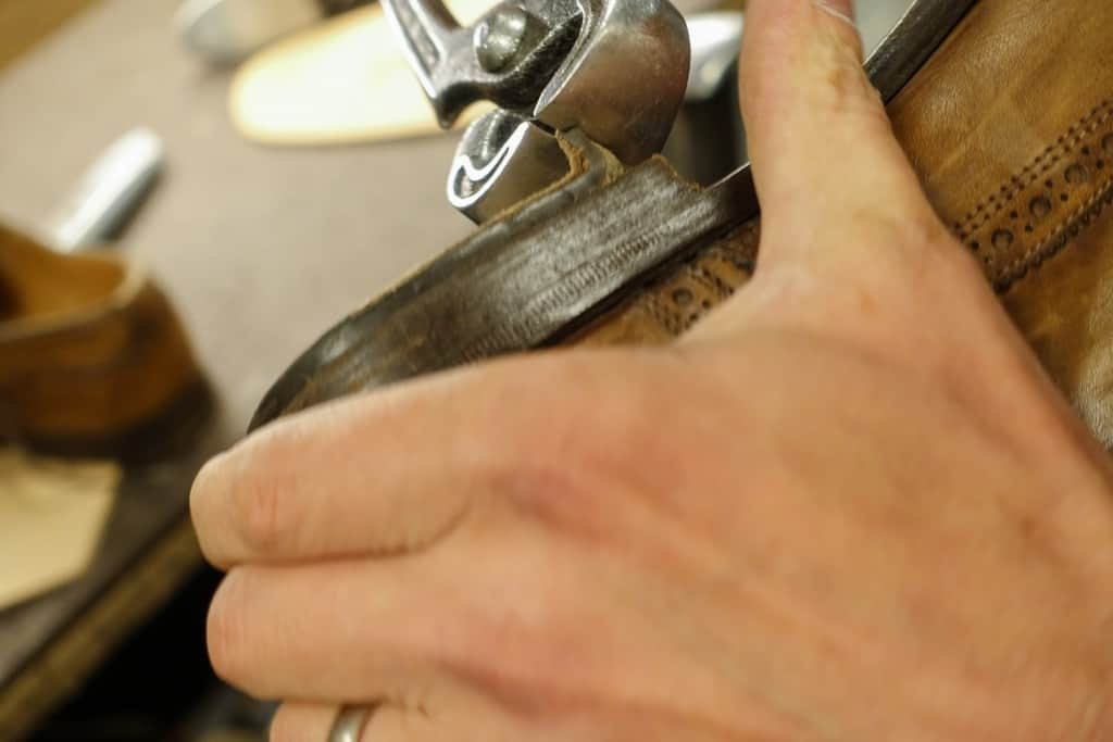 The outer part of the heel with the rubber piece is torn away.
