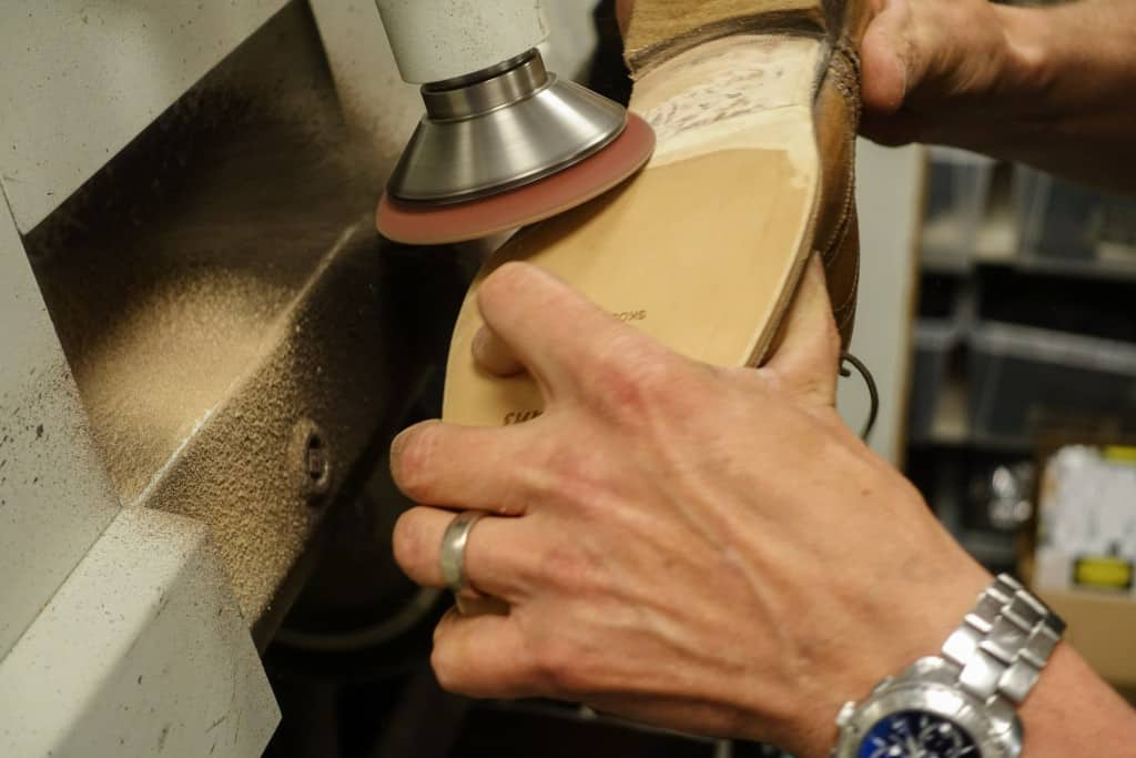The transition between the old and the new smoothed, and sanding also bottom surface of the old sole.