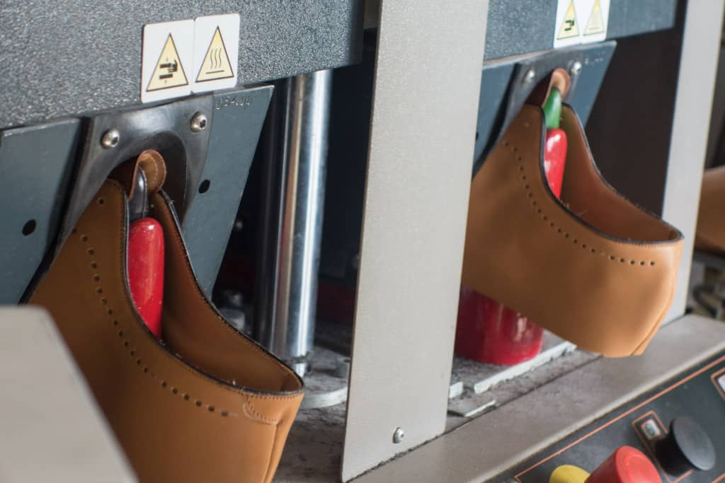 The machine shaping the uppers. The shoes are in it for about half a minute.