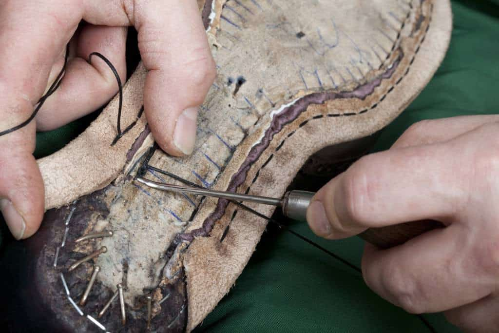 When hand welting a holdfast is cut out of the insole (except in Italy, where shoemakers usually do the stitching to the flat sole by digging the awl down and up) which the welt seams is stitched to, connecting uppers and welt. Picture: Claymoor's List