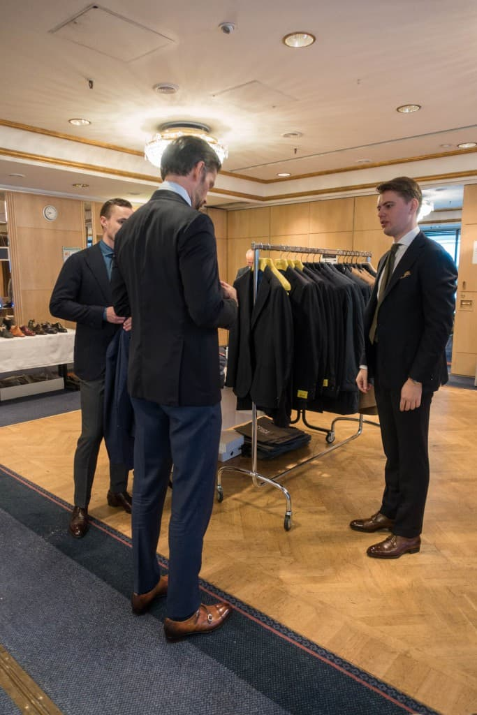 Adam Nohlborg and Johan Wiklund from Spiga 3 helps a customer trying on a Gabo jacket.