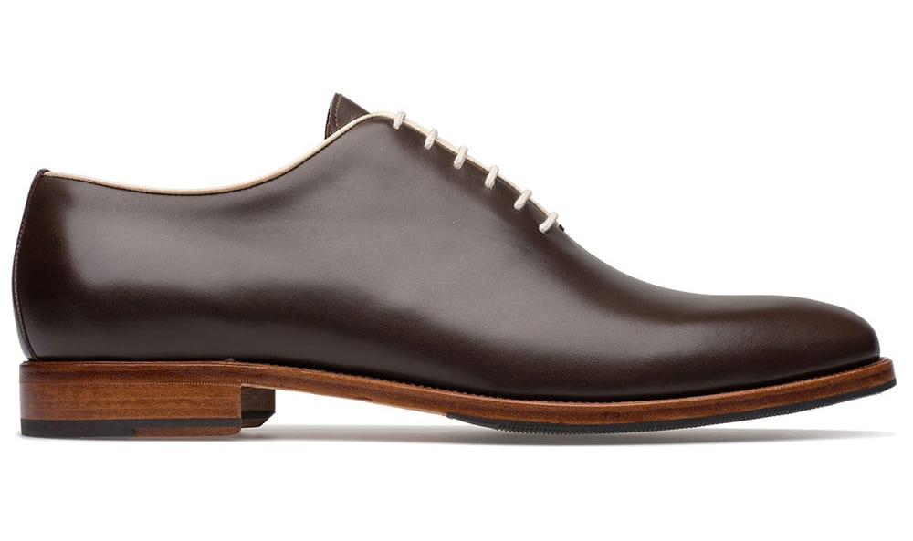 A nice wholecut with cream piping and laces and natural colored sole edges.