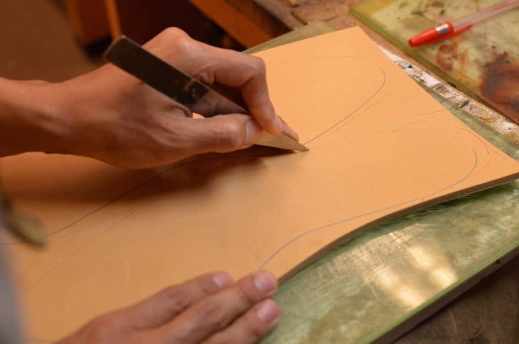 The insoles are cut out of a thick piece of vegetable tanned leather from the shoulder of an animal.