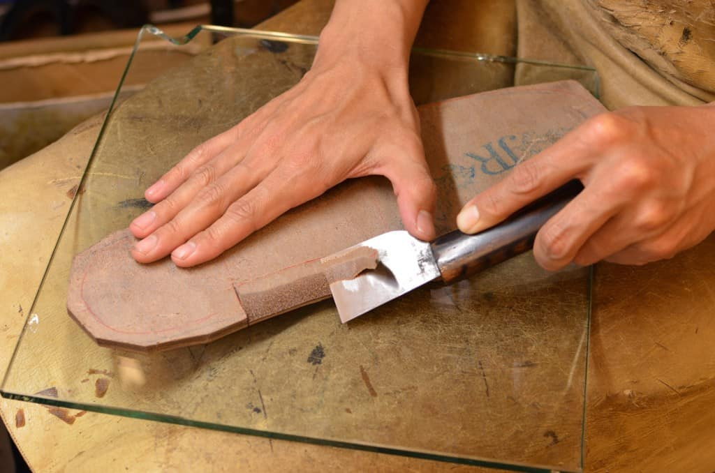 TIme for the outsole, and here they start preparing for the bevel and blind welt right away.