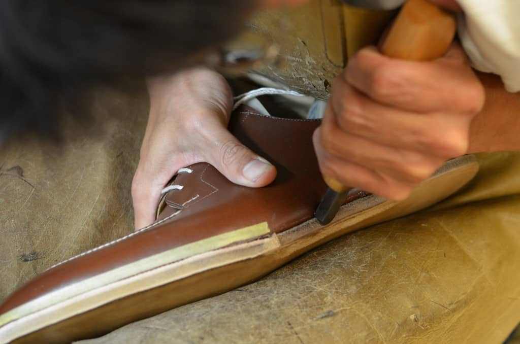 Here the blind welt has been finished and an edge iron is used to even out and shape the edge.