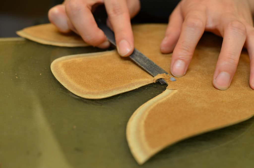 Skiving the edges to get a smooth transition between the pieces.
