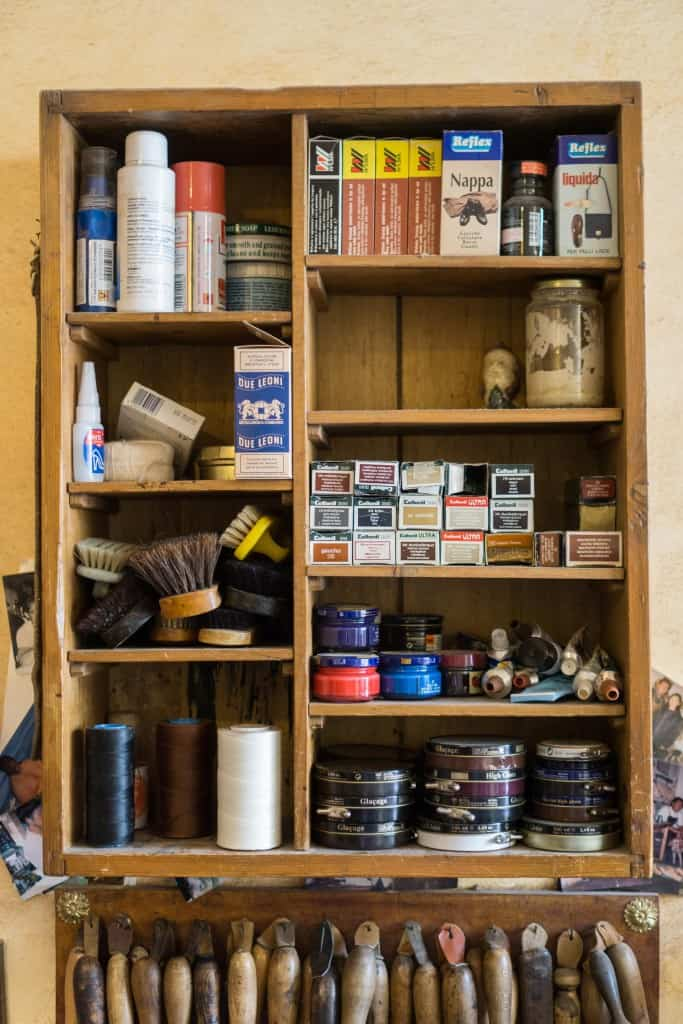 Shelf with shoe care products, leather dye and more.