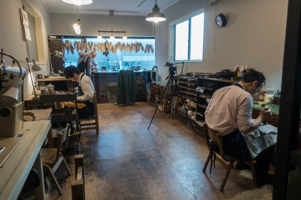 The workshop, with Yohei's workbench by the window, and his apprentices on each side of the room.