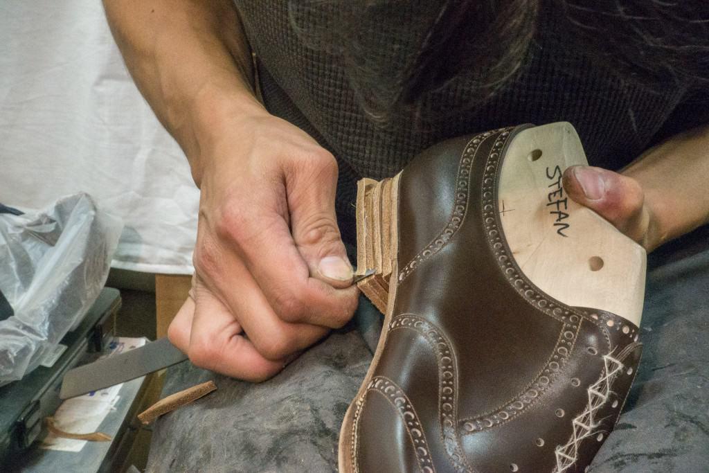 Heels being trimmed in the workshop.