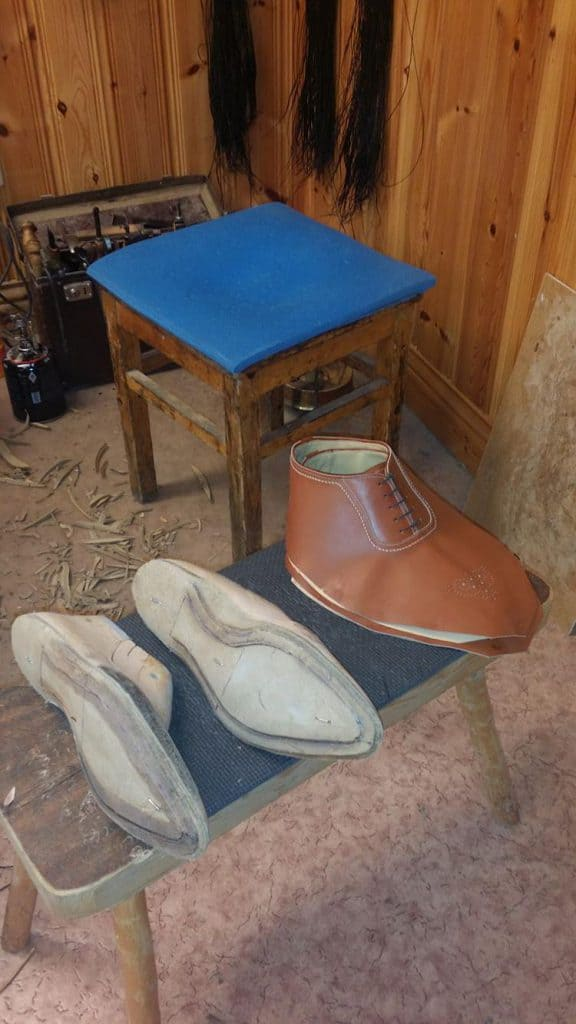 Here the uppers are more or less ready, and the holdfast for the welt stitching is carved out of the insoles.