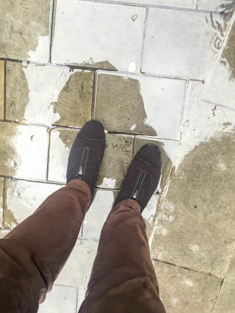 On the feet.