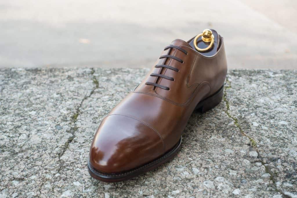 Plain cap toe Hanover in dark brown.