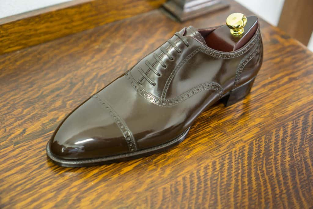 Quarter brogue on a last with an almond shaped toe. Very elegant.