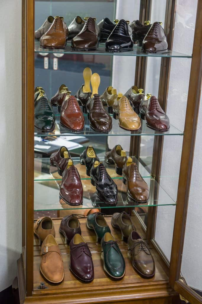 Display cabinet with sample shoes.